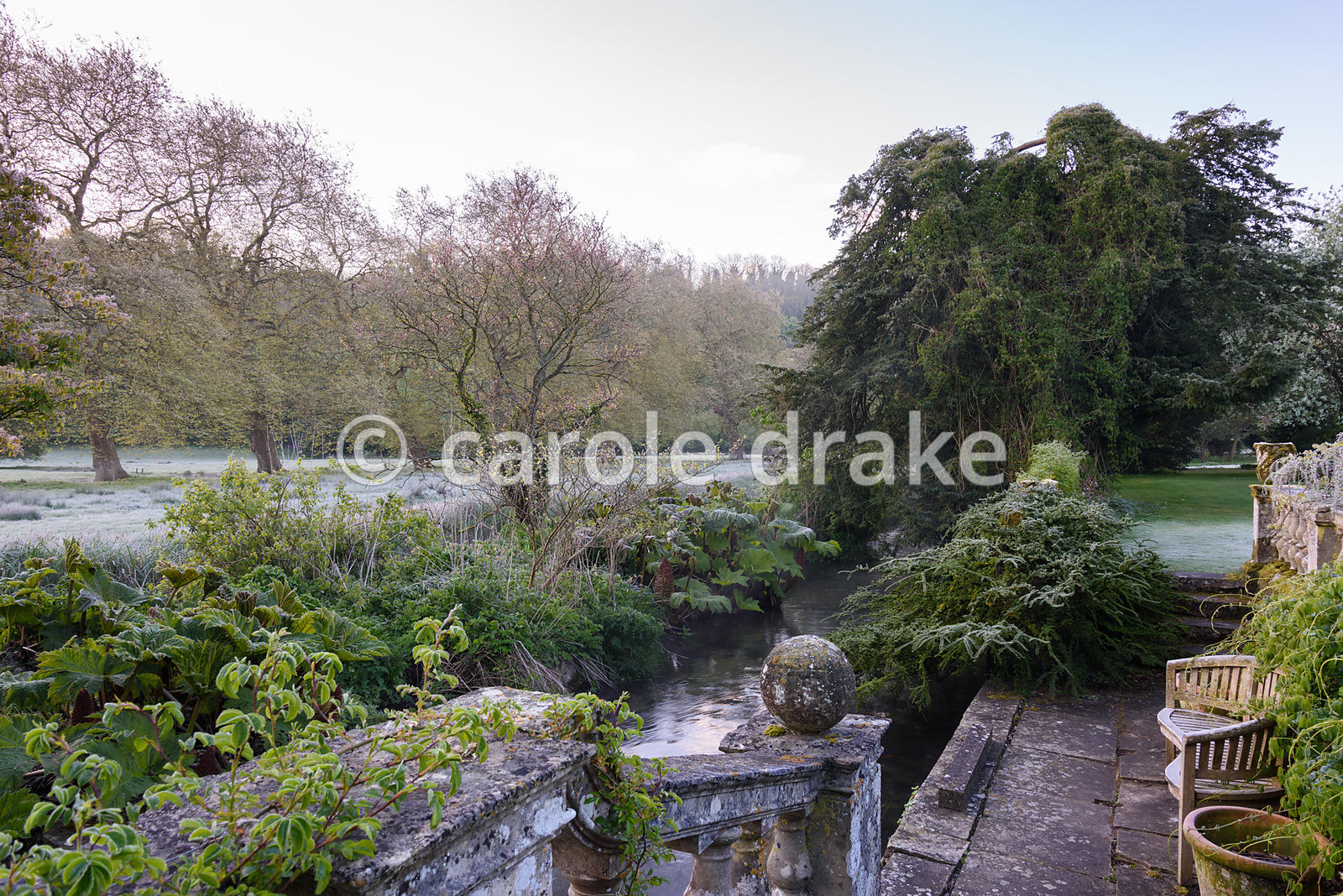 The boat terrace on a frosty April morning at Heale House, Middle Woodford, Wiltshire with water meadows beyond