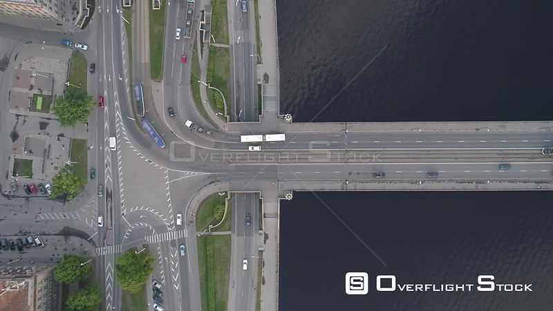 Aerial topdown drone shot of traffic on a bridge over river in Riga, Latvia