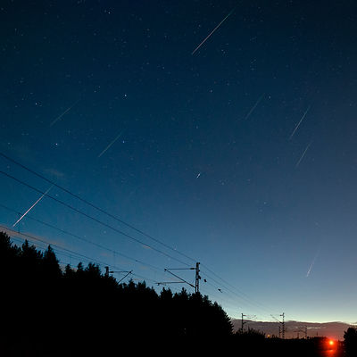 11 Perseid meteors above railroad in Lahti, Finland on 14 Aug 2018. Composite image.