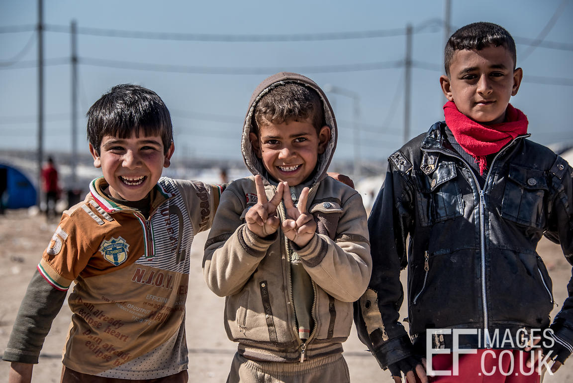 Three Little Boys, Grinning Despite Their Difficult Circumstances At Hamam al Alil IDP Camp Near Mosul