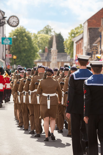 Soldiers from 142 Vehicle Squadron March towards Banbury Cross