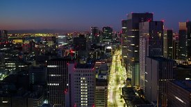 Bird's Eye: Streets Turn From Gold To Gray During Sunrise Over Tokyo (Night To Day)