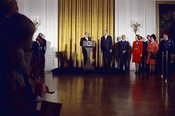 Gerald R. Ford standing nearby, Mrs. Ford and others to left of podium - taken down center aisle from back of room – Arrival ...