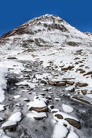 Small apline brook coated in fresh snow at the summit of Rohtang Pass, Manali, India