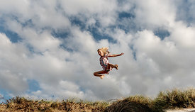 Danish girl jumping at Klitmøller beach 3