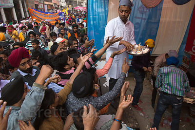 Free food is given out during a Sikh festival in Delhi, India