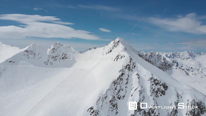 Aerial reveal shot of Alps over Pitztal glacier in Tyrol, Austria