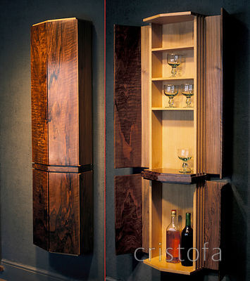 a walnut and oak drinks cabinet