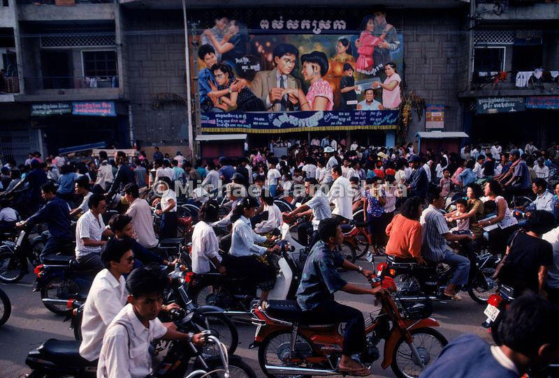 Phnom Penh on Sundays teems with what seems like its entire population mingling in the crush of wheels. Cambodia.