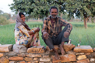 Wheat farmer and his granddaughter in Kharekhari village, Rajasthan, India