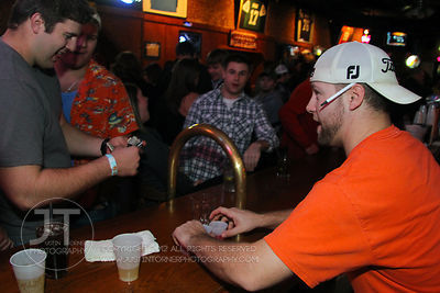 Patrons order at the bar at the Sports Column, 12 S. Dubuque Street, in downtown Iowa City Saturday night. Copyright Justin T...
