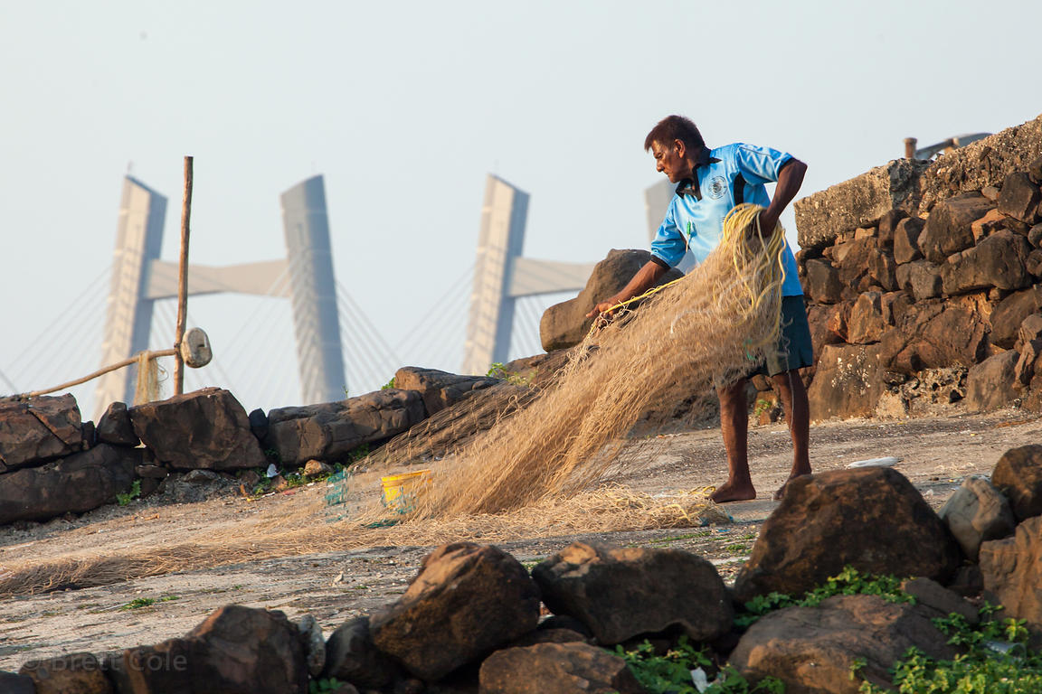 A man tends a net in the fishing village of Worli, Mumbai, India.