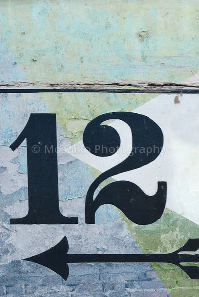old fashioned number twelve on textured abstract background - earthy colors - graphic design