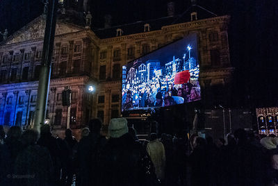 Amsterdam, Netherlands 2015-01-08: Projection screen on the Dam, giving an impression of the crowd.