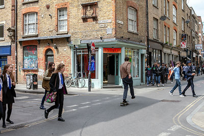 A Man Skateboards Down Brick Lane