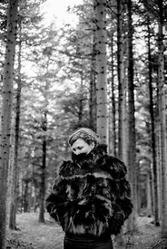 Woman in fur coat in the forest #1