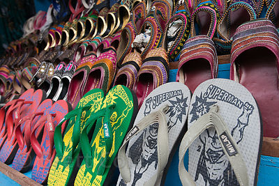 Superman sandals, Pushkar, Rajasthan, India. Flip flops are a very common form of footwear in India.