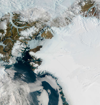 EARTH Greenland -- 16-17 Jul 2012 -- The Petermann Glacier (top centre left) on the sea along the northwestern coast of Green...