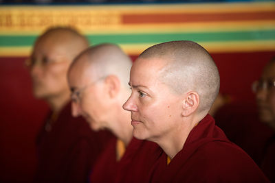India - Sarnath - Disciples listen to a lecture by The Karmapa Lama at the Vajra Vidya Institute for Buddhist studies
