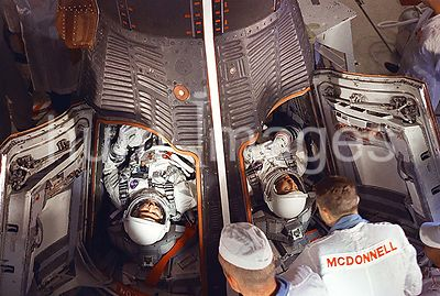 (21 Aug. 1965) --- Astronauts L. Gordon Cooper Jr. (left) and Charles Conrad Jr. are seen in the Gemini-5 spacecraft in the w...