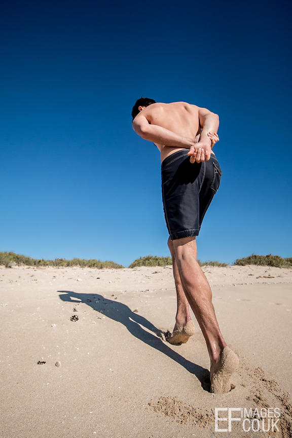 Man Tiptoeing On The Sand, Low Angle