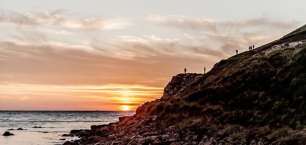 People on the cliffs near Hammer Harbour on Bornholm, Denmark