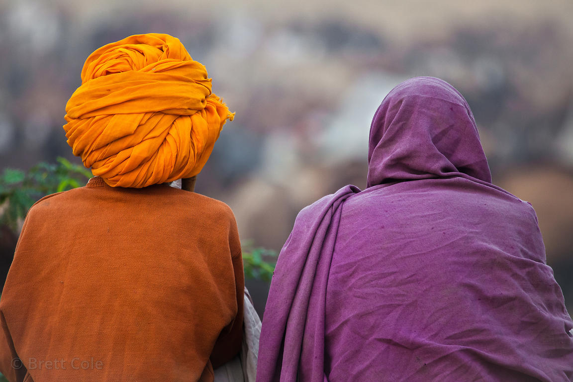 Husband and wife in colorful dress at the 2010 Pushkar camel fair, Rajasthan, India
