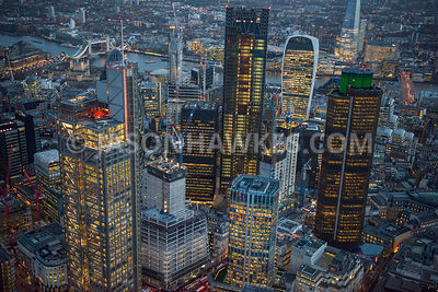 Aerial view of City of London skyline at night.
