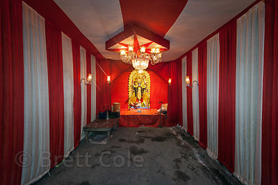 An idol of the goddess Kali in a pandal during the Kali Puja festival, in Lake Gardens, Kolkata, India.