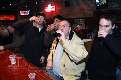 Bar patrons and Tom fill the Airliner Bar, 22 S Clinton Street in downtown Iowa City Saturday night. Copyright Justin Torner ...