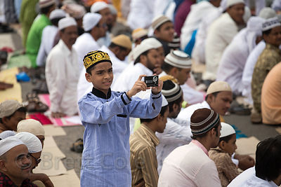 A Muslim boy takes photos during Eid al-Adha, Red Road, Madian, Kolkata, India. I have the only photos taken by a foreigner o...