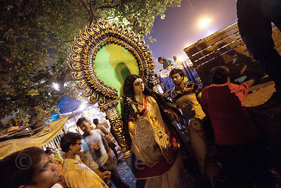 Families bring idols of the Hindu goddess Lakshmi to Babughat in Kolkata, India, to immerse them in the Hooghly River. Lakshm...