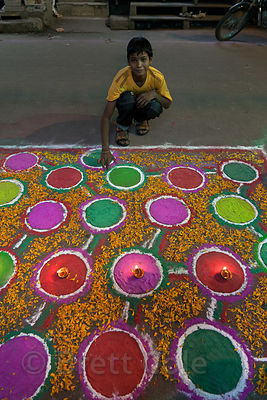 A boy shows off his chalk drawing during Diwali in Jaipur, Rajasthan, India