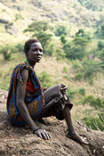 Woman in traditional Tepith homstead on Mount Moroto in the heart of Karamoja, northern Uganda