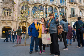 Tourists taking selfies in front of Casa Batllò, an architectural masterpiece by Antoni Gaudí in Barcelona, Spain
