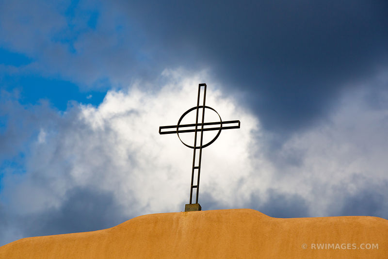 CHURCH CROSS AND STORMY SKY SANTA FE NEW MEXICO ARCHITECTURE COLOR