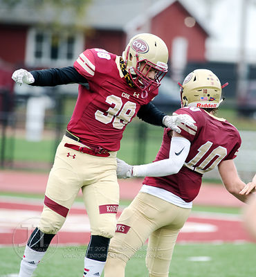 Coe College's Zach Moya (38) and Peyton Hesse (10) celebrate a safety by Central during the first half of play at Clark Field...