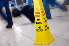 Caution Wet Floor Sign with People Walking Picture