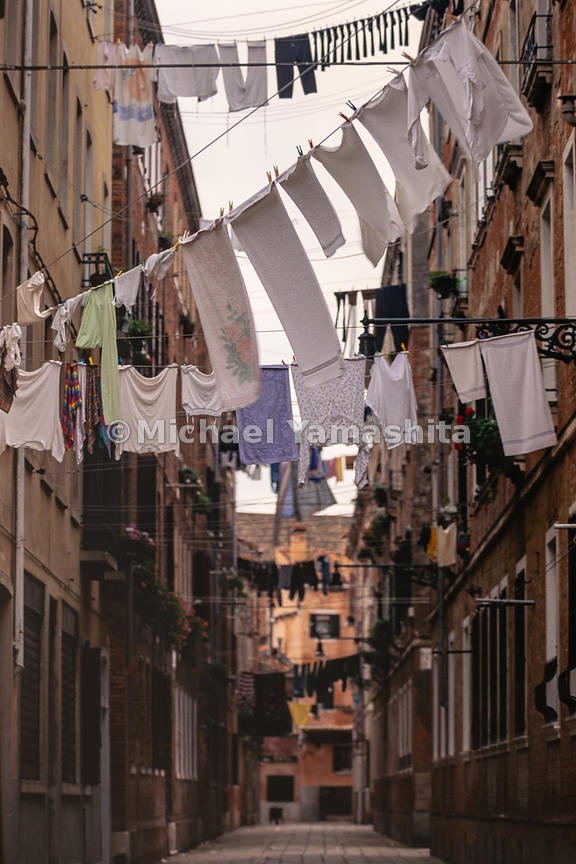 Clothes dry on the lines in a narrow alley. Venice, Italy, October, 1982.