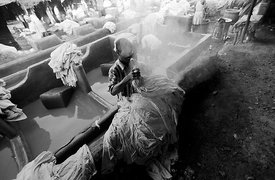 A Dhobi or washermen at the ghats in Bombay (now Mumbai) in India