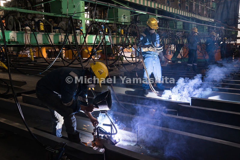 Panel-line welding is underway in a steel fabrication workshop at Semcorp Marine Tanjong Kling Yard.