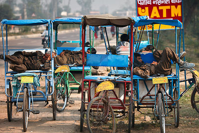 Rickshaw drivers sleeping in Bharatpur, Rajasthan, India