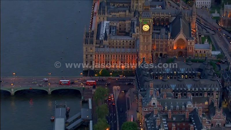 Aerial footage of Union Jack flag at the Houses of Parliament at night, Westminster, London, England, UK