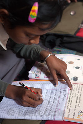 A girl transcribes Hindi text at a school in Varanasi, India operated by Dutch NGO Duniya (duniya.org)