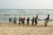 Fishermen pulling in fishing nets on the beach, Beyin, Ghana