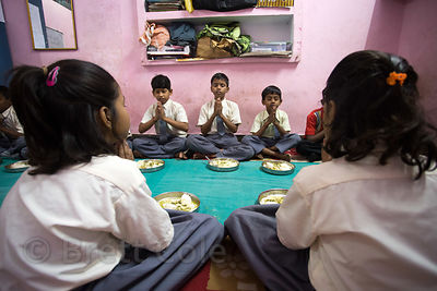 Students pray before lunch at a school in Varanasi, India operated by Dutch NGO Duniya (duniya.org)