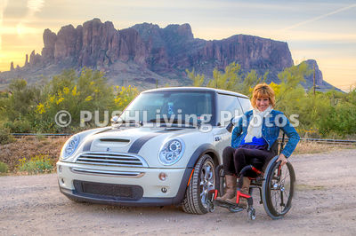Woman using a wheelchair exploring an historic outdoor museum