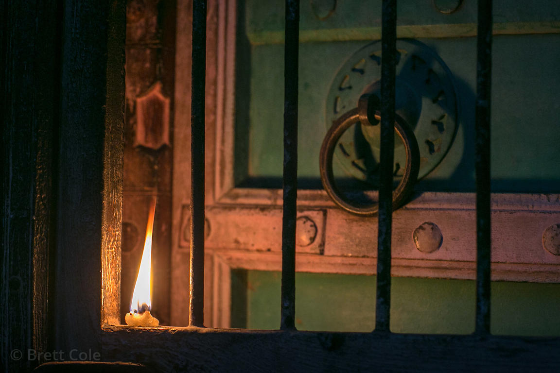 Candle on a doorstep during Kartik Purnima, Pushkar, Rajasthan, India