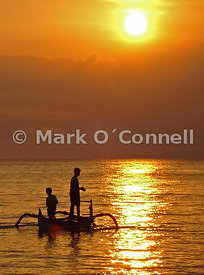 Bali boys fishing at sunset