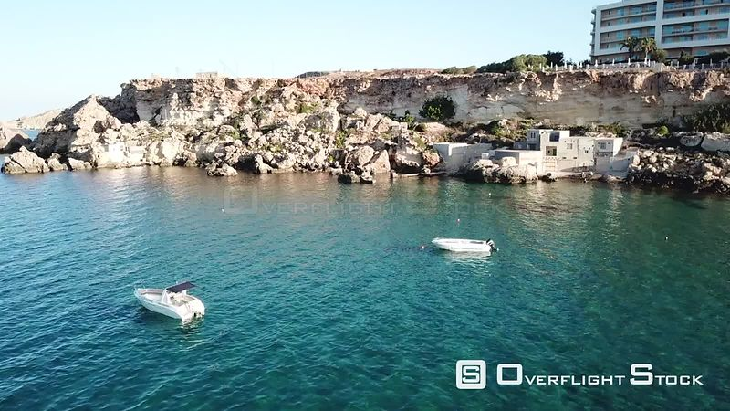 Boats and Fishermans Buildings Drone Video Golden Bay IrRamla talMixquqa Malta